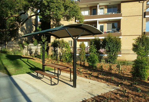 curved roof shelter with piazza setting